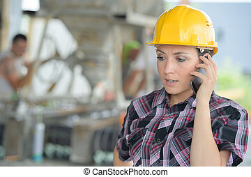 female construction organizer on the phone