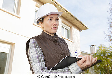 female construction organizer outdoors