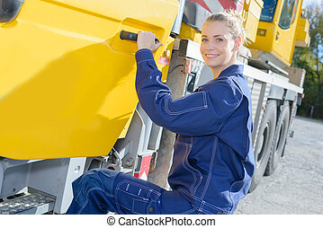 female construction worker getting into truck cab
