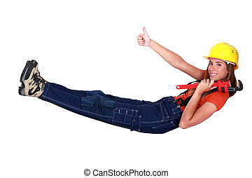 Female construction worker giving a thumbs up