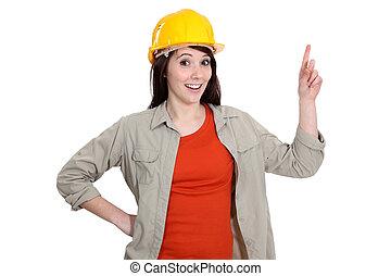 Female construction worker holding up her finger