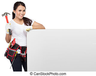 female construction worker in action - portrait of Female...