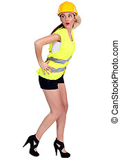 Female construction worker in shorts