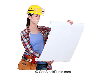 Female construction worker looking at plans
