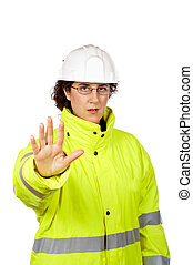 Female construction worker saying stop