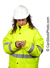 Female construction worker send a SMS, over a white...