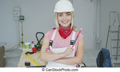 Female construction worker standing at workbench - Beautiful...