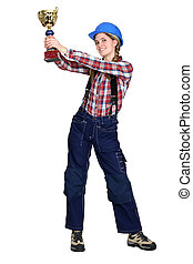 Female construction worker with a gold cup