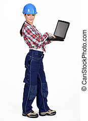 Female construction worker with a laptop