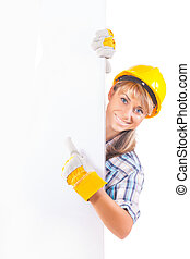 Female construction worker with blank board isolated on white
