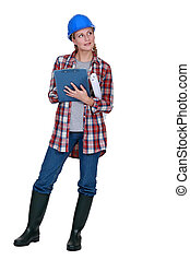 Female construction worker with clip board