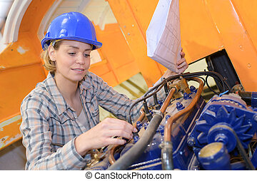 female construction worker with heavy equipment