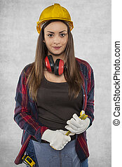 Female construction worker, working as plumber
