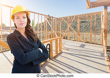 Female Contractor In Hard Hat At Construction Site