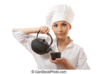 female cook / chef in uniform with teapot
