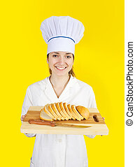 cook holding bread on cutting board