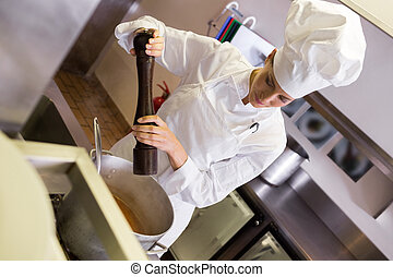 Female cook preparing food in kitchen