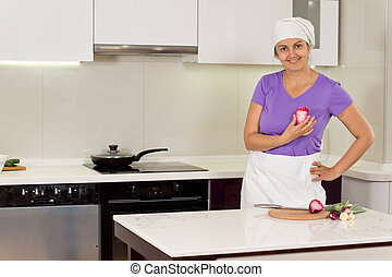 Female cook standing with hand on waist