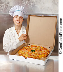 female cook with fresh  pizza