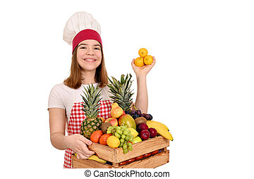 female cook with lemons and other fruit in wooden crate