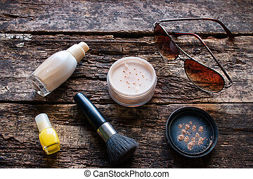 female cosmetics on a wooden background