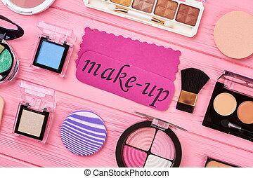 Female cosmetics set, top view.