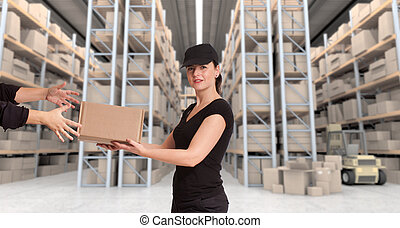 Female courier at distribution warehouse a