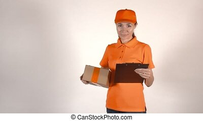 Female courier in orange uniform holding a cardboard box. 4K studio shot, isolated
