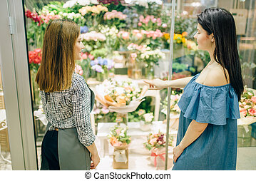 Female customer and florist chooses flowers