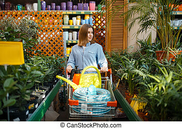 Female customer buying tools for floristry