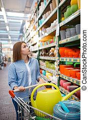 Female customer buying tools for gardening
