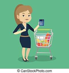 Female customer counting on calculator. - Caucasian woman...