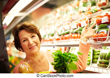 Female customer - Image of senior woman in groceries ...