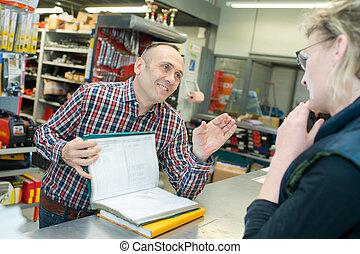 female customer in a tool store