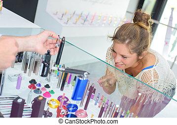 female customer purchasing a vaporiser