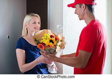 Female customer receiving flower bouquet