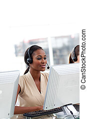 Female customer service agent with headset on working at a ...
