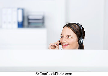 Female Customer Service Executive Using Headset