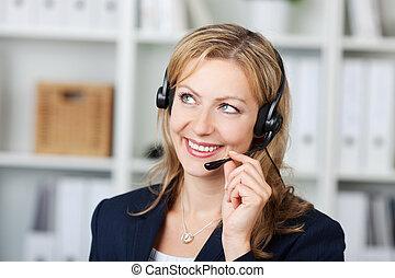 Female Customer Service Operator Using Headset
