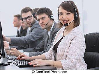 female customer service representative and colleagues in the...