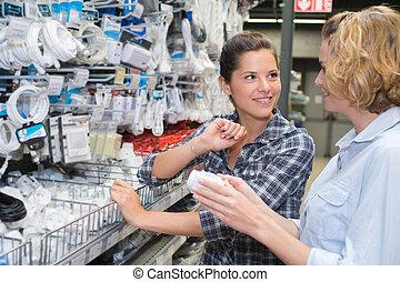 female customer shopping at electronics supermarket