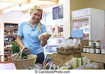 Female Customer Shopping In Farm Shop