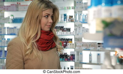 Female customer shows her thumb up at the drugstore - Pretty...