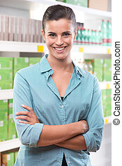 Female customer smiling at supermarket