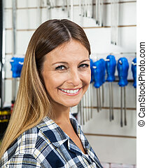 Female Customer Smiling In Hardware Shop