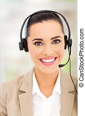 female customer support operator with headset smiling -...