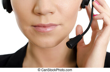 Female customer support operator with headset. Part of face....