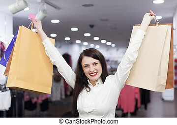 Female customer with shopping bags