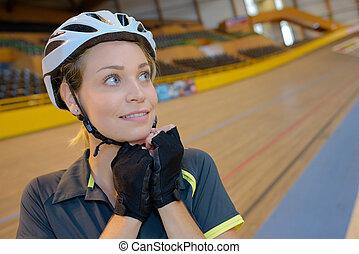 female cyclist at velodrome