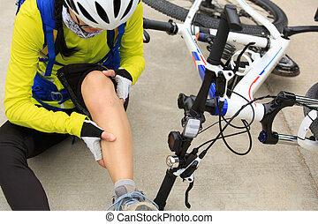 female cyclist getting injured while falling from mountain...